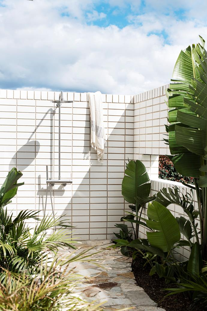 "An [outdoor shower](https://www.homestolove.com.au/outdoor-shower-ideas-19532|target=""_blank"") from Reece where the children rinse off after going for a swim."