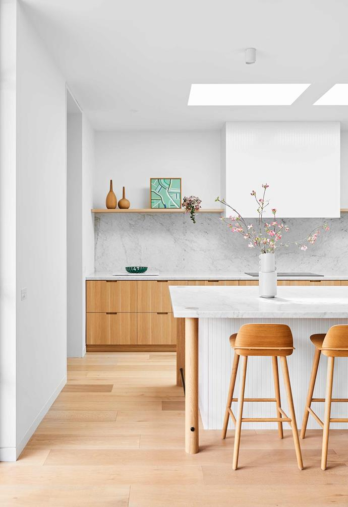 "**Kitchen** ""We love the streamlined look and that everything, including the integrated appliances, is hidden,"" says Peta. The kitchen's cabinetry and bespoke island bench with rounded legs took their cues from the [Muuto](https://muuto.com/