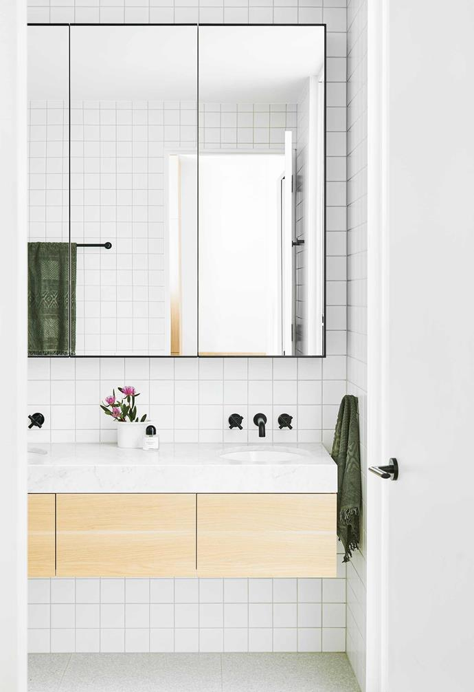 **Ensuite** All the bathrooms in the house have a consistent look. Carrara marble and a blond-timber vanity soften this beautifully detailed space.