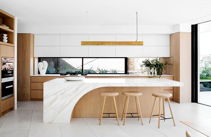 Porcelain benchtops in Calacatta from Maximum (island). Oak joinery (throughout). Integrated Fisher & Paykel refrigerator. Cooktop, Pitt Cooking. Baxter 'Blade' suspension light, Criteria. Mater High stools, Cult.