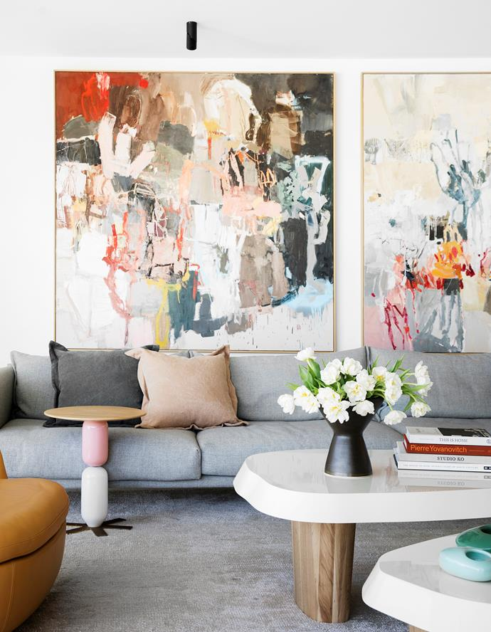 Moroso 'Gentry' sofa, Hub Furniture. Pierre Augustin Rose 'Duo Multilaque' coffee table, India Mahdavi 'Lolita' side table and turquoise vessels, all Studio ALM. Vase, Ondene. Cushions, Jardan. Artworks by Leah Thiessen.
