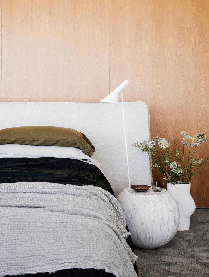 Rodolfo Dordoni 'Rever' bed, Poliform. Cappellini 'Bong' side table and AJ floor lamp, both Cult. TTR vessel by Humble Matter, Curatorial+Co. Bedlinen, Bedouin Societe. Tamino carpet, Whitecliffe Imports.