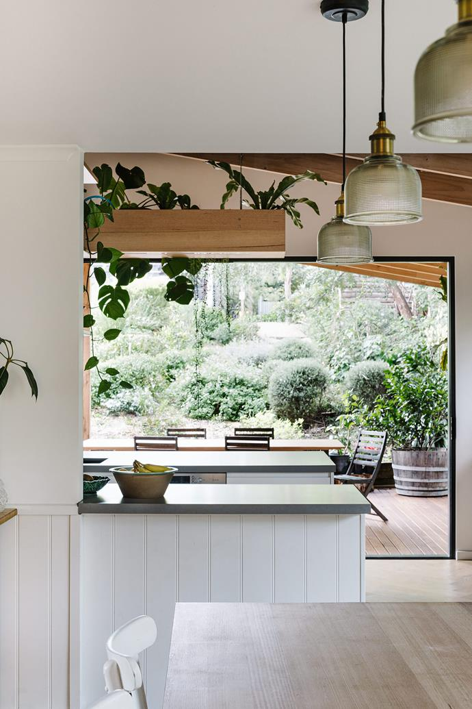 The view of the garden from the kitchen enhances the indooroutdoor feel.