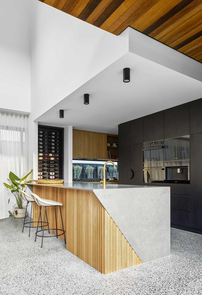 """**Kitchen** """"I like the fact that the house is unexpected — its look, its layout and its finishes,"""" says Joelle. """"The breakfast bar and timber mouldings are Cirque Tasmanian Oak from [Porta](https://www.porta.com.au/