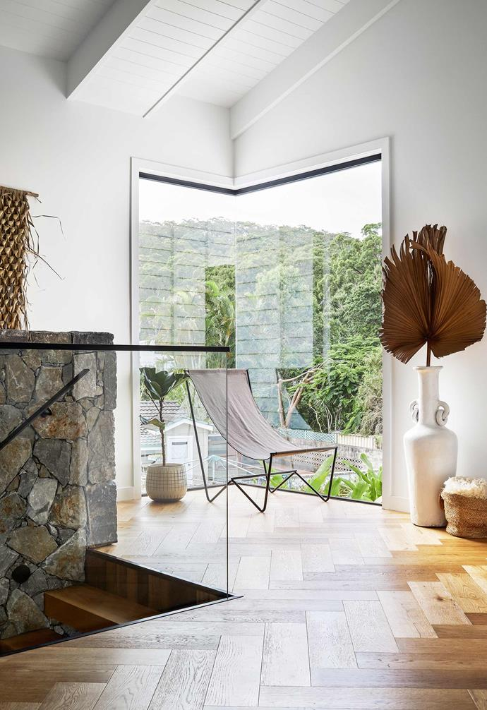 """**Landing** On the first floor is a large corner window that illuminates the staircase and upper level. Sitting daintily on the Balmain Oak herringbone flooring is a thinly framed Kiyo Slouch chair from [April & Oak](https://aprilandoak.com.au/