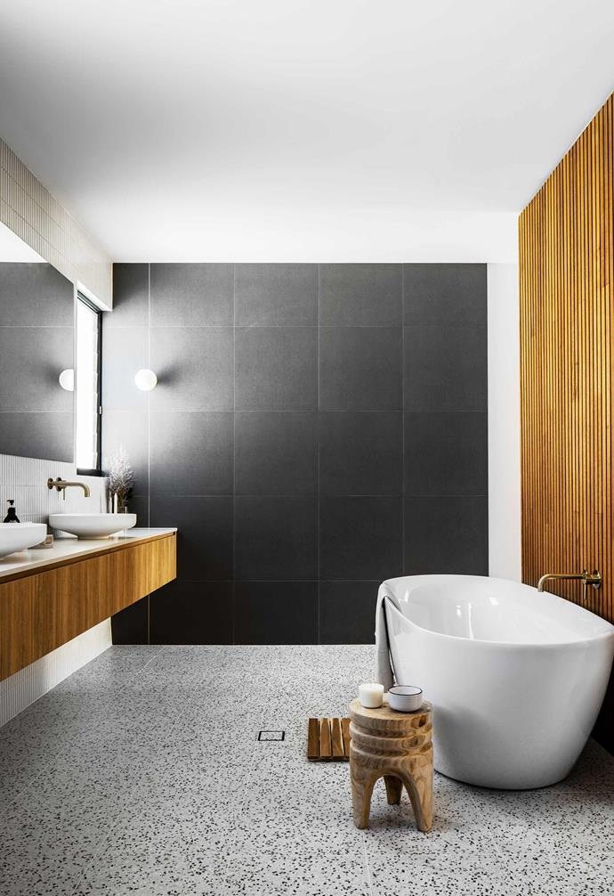 """**Ensuite** """"We're spoilt for choice between the dual rain shower heads, a hand-held shower and a bench seat relax or soak in the tub,"""" says Joelle. Kado bath, [Reece](https://www.reece.com.au/