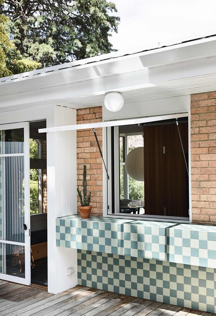 """This funky servery was designed by Victoria's Kennedy Nolan architects to better connect the Modernist Anatol Kagan home to its garden. The gas strut window design was """"an investigation of colour, materiality, pattern and detailing"""", says Kennedy Nolan's head of interiors Adriana Hanna."""