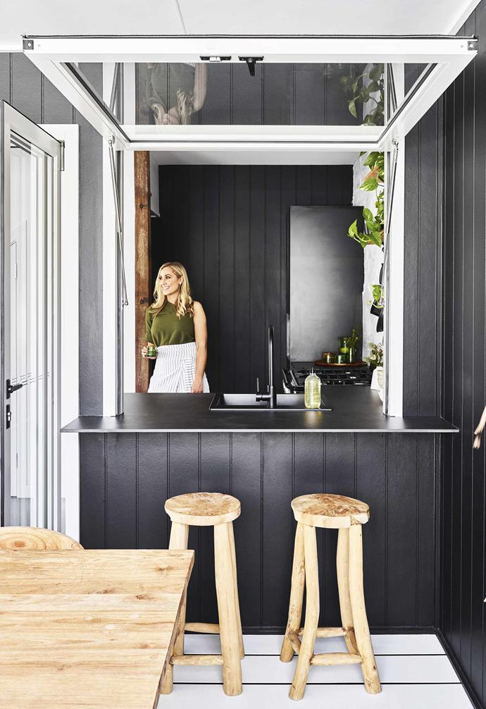 """Opting for stark white aluminium window frames helps to create a dramatic modern contrast in this [Queensland pool house's](https://www.homestolove.com.au/pool-house-19517