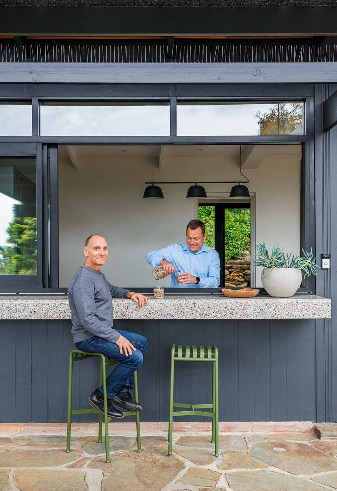 """The freckled terrazzo bench makes the servery window a highlight in this [mid-century modern style home in the Adelaide Hills](https://www.homestolove.com.au/mid-century-modern-home-adelaide-hills-21553