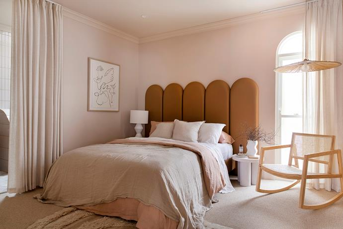"""Arched windows and wardrobe doors and a custom-made bedhead by [Create Estate](https://www.createestate.com.au/