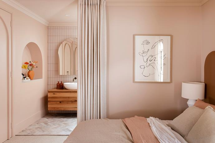 A curtain creates privacy for the master ensuite while adding a sense of softness and drama.