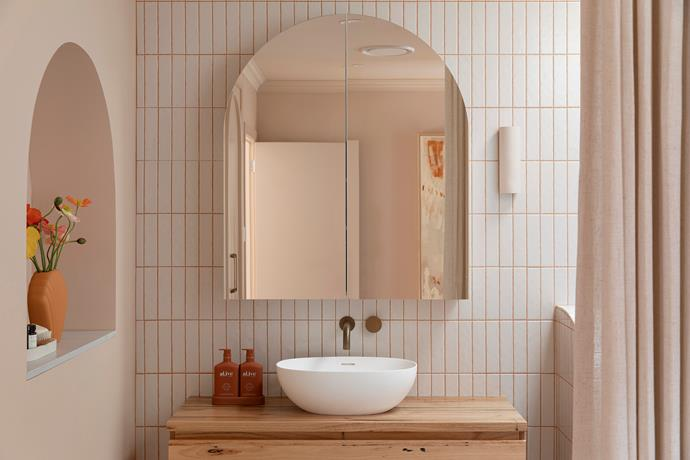 Newport Gloss Mini Subway Bone tiles from Tile Cloud line the walls of the master ensuite.