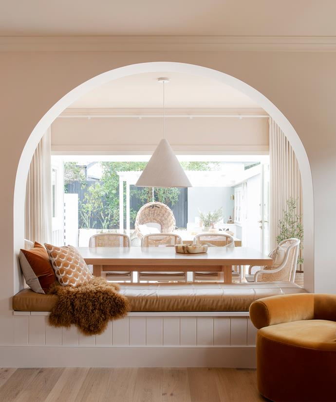 Underneath the curved arch wall, the Three Birds built a large double-sided bench seat which offered not only additional seating for both rooms but also provided plenty of storage room inside.