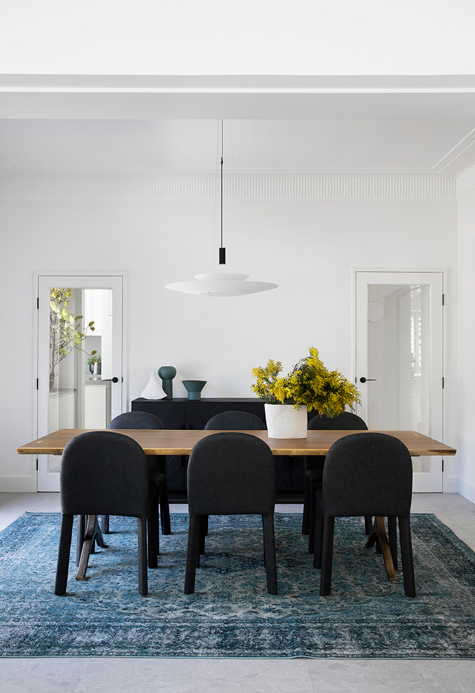 "The 1903s home was modernised with contemporary [pendant lights](https://www.homestolove.com.au/14-pendant-lights-that-pack-a-punch-2989|target=""_blank"") and glass doors."