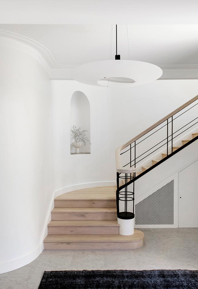 Soft grey terrazzo-look floor tiles run throughout the ground floor.