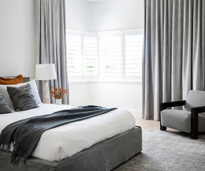 A variety of grey tones in the master bedroom make it a calm space.