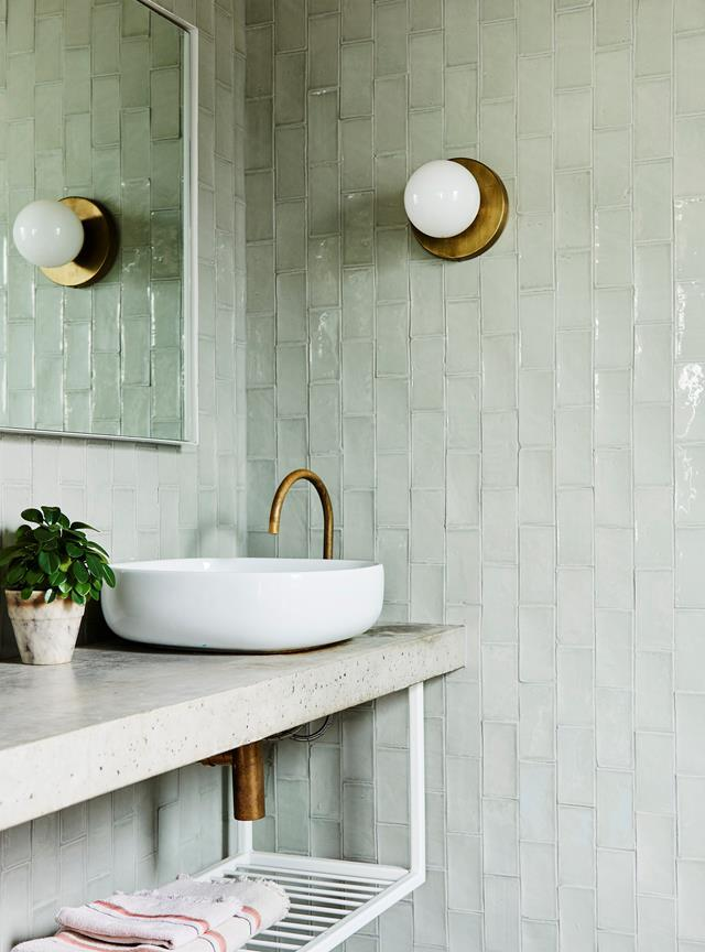 "Soothing pale green tiles have been elegantly paired with aged brass tapware in the bathroom of Artist Prudence Oliveri's bold and beautiful [Jan Juc home](https://www.homestolove.com.au/prudence-olivieri-home-21346|target=""_blank"")."