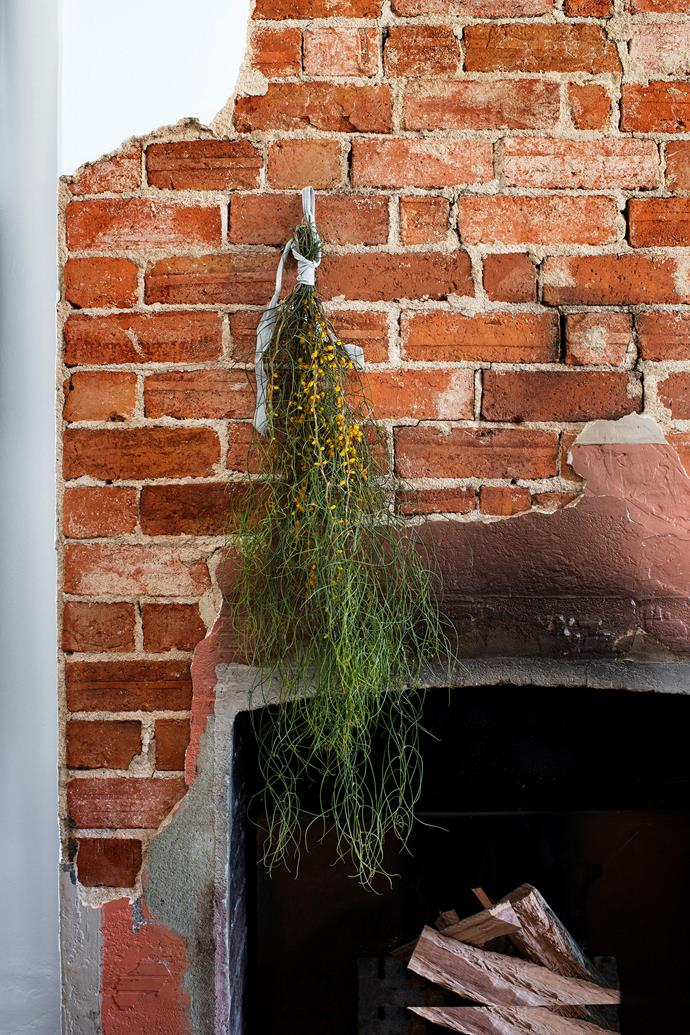 The handmade bricks lend warmth and patina to the living room fireplace.