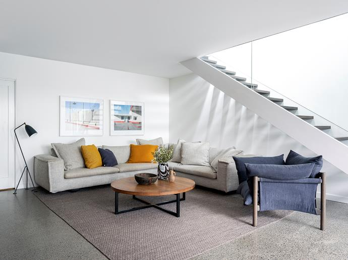 """Sunny sofa and Wilfred armchair, Jardan. """"I'm a huge supporter of Australian design,"""" says Annie. Sherpa rug, Armadillo. Artworks by George Byrne from Olsen Gallery."""