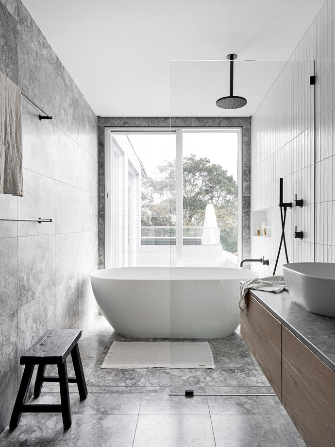 Bath from Cass Brothers. All tiles and stone sourced from Surface Gallery. Sussex Scala tapware, Reece. Black timber stool, Water Tiger.