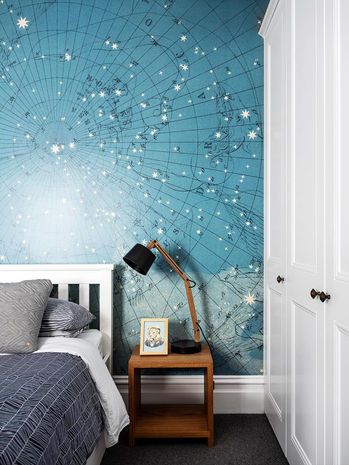 The striking Atlas of Astronomy wall mural is from Rebel Walls. Bedside table and lamp, both Mark Tuckey.