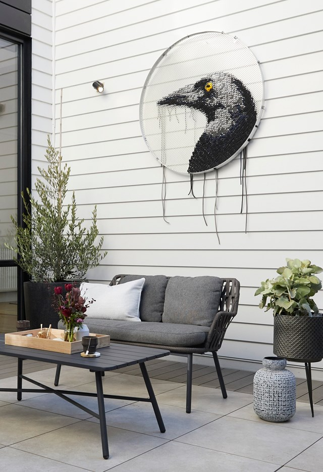 **Week 12, Backyard and Pool** The judges were immediately impressed by the immense size of Daniel and Jade's courtyard and Shaynna applauded the clever division of space with the contrast of tiles and decking. A feature artwork of a magpie in the courtyard makes a bold statement.
