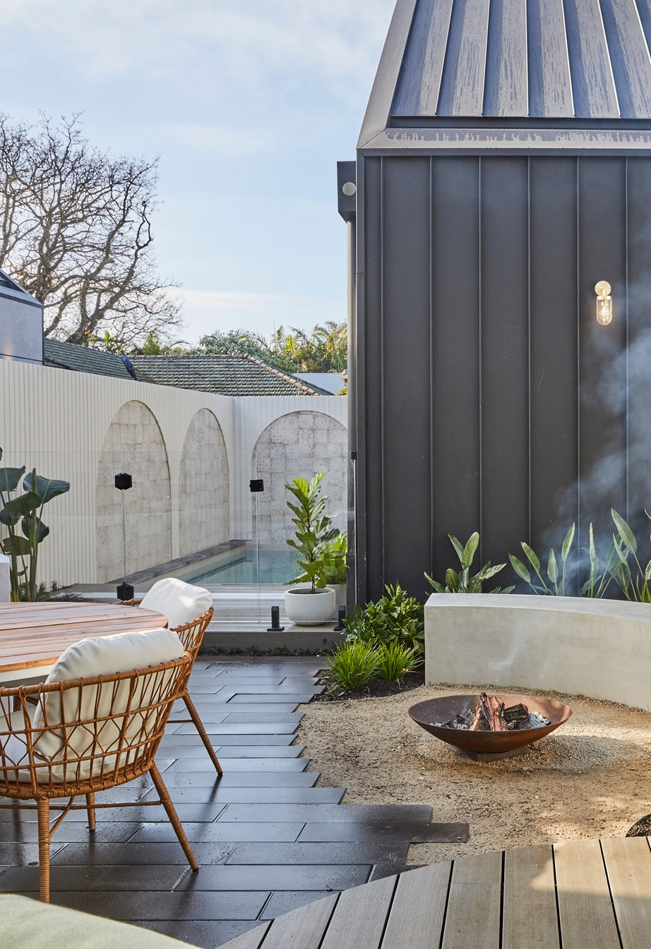 **Week 12, Backyard and Pool** Luke and Jasmin's backyard is a dreamy coastal-inspired escape that embraces subtle curves and outdoor entertaining.