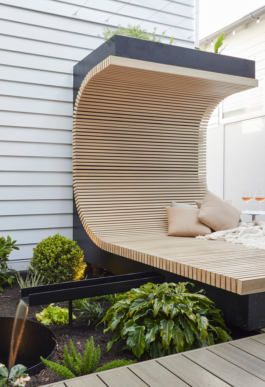 **Week 12, Backyard and Pool** With a pizza party pit, resort-style pool area and this custom-built, curved daybed, this multi-functional backyard could very well win Luke and Jasmin The Block.