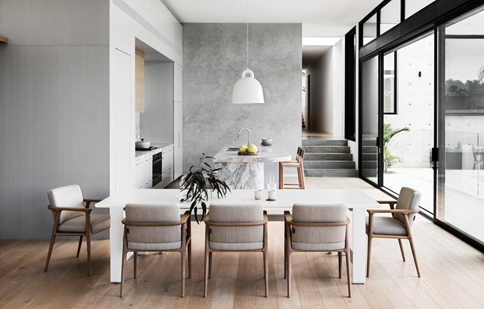 Moooi 'Zio' dining chairs from Space have been paired with a dining table from Coastal Living, seamlessly blending with the palette of moody greys and whites.