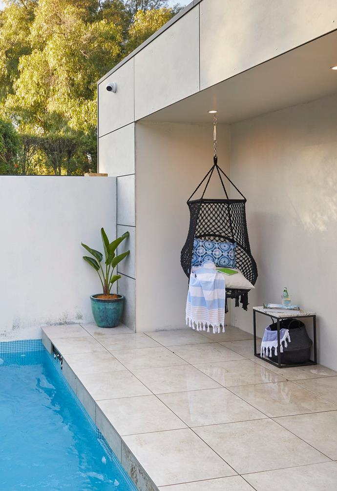 **[Week 12, Backyard and Pool Week](https://www.homestolove.com.au/the-block-2020-backyard-pool-reveals-22011)** The pool space features simple tiles in keeping with the rest of the backyard area, and is furnished with a hanging chair for relaxing.