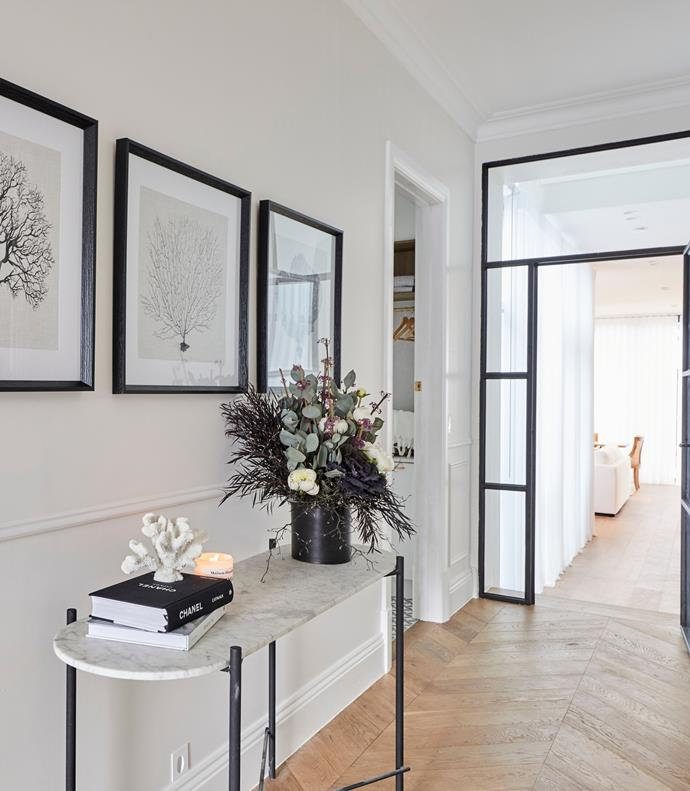 **Week 9, Hallway** Chevron timber flooring and wall panelling maximised the period feel of Luke and Jasmin's 1910s home, while the steel-framed door provided the perfect entryway into the modern quarter of the house.