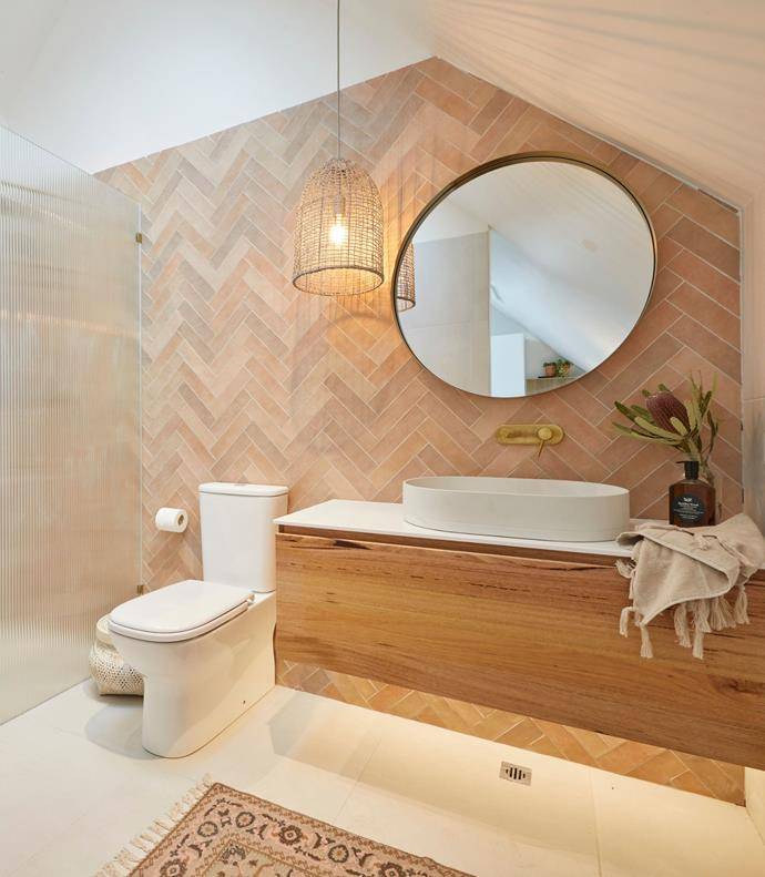**Week 11, Studio and Garage** Despite not having a door, the powder room in Luke and Jasmin's studio packed a punch with its herringbone tile wall, statement pendant and beautiful timber vanity.