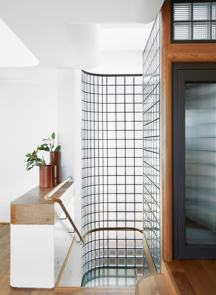 The stairway and liftwell are lined with Obeco glass blocks allowing natural light to flood the home. Vessels from Ondene.
