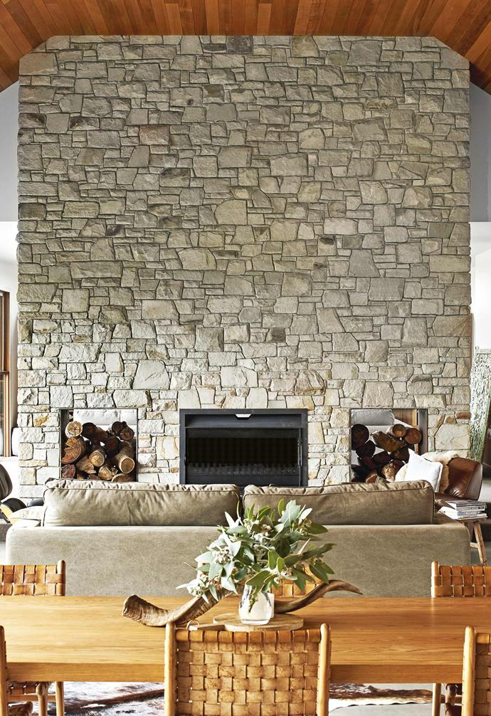 "**Living area** A grand Mt Angus sandstone fireplace wall dominates this space, which is crowned by a western red cedar timber ceiling. The family can gather on the comfortable 'Square Loungy' sofa from Weylandts. Artworks: (on left wall) Sid Dickens *Memory Blocks*, [Alfresco Emporium](https://www.alfrescoemporium.com.au/|target=""_blank""