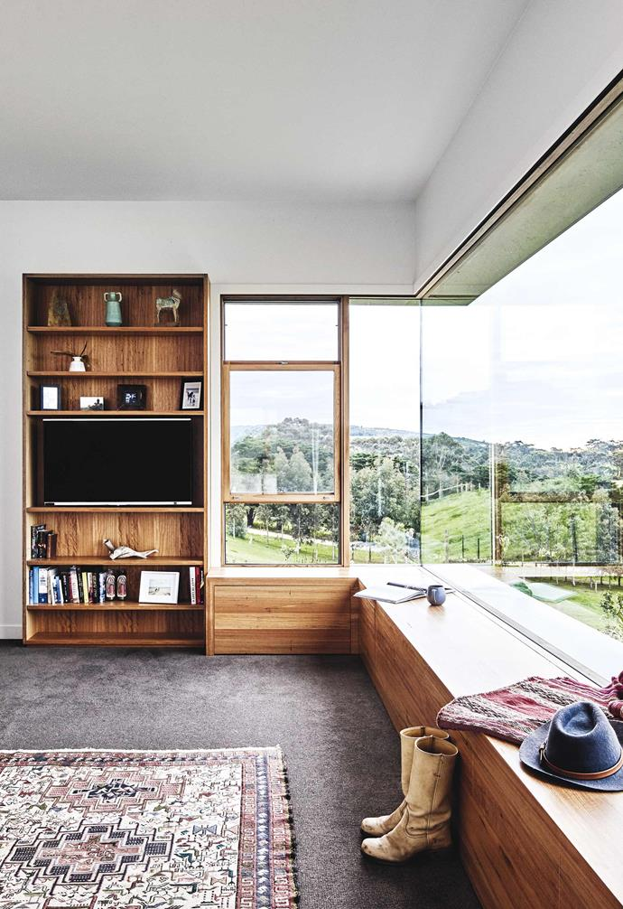 "**Master bedroom** Architect Dan designed the wraparound windows to capture all the day's moods. ""We see the sunrise from here because we have no blinds or curtains, and we can watch the sunset,"" says Deb. ""It's phenomenal."""