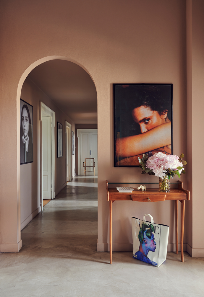 Candela's career success is illustrated in her home with a succession of professional portraits, including the Andrea Spotorno photograph hanging in the entry hall above a vintage console table and Patrick Demarchelier's black and white work in the passage way.