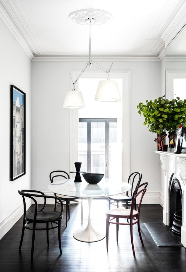 "Once the domain of pigeons, this [Victorian-era terrace](https://www.homestolove.com.au/victorian-era-terrace-modernist-update-21694|target=""_blank"") has been revived with an infusion of light and space and furnished with an enviable flock of modernist classics. Round dining tables are perfect for encouraging social interaction without obstructing flow in a room."