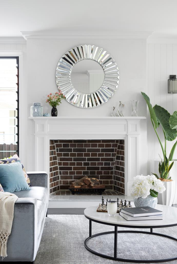 """The front 'good room' is Justine's tranquil haven. """"I wanted it to feel luxurious and feminine,"""" she reflects of the space filled with pieces from Coco Republic, including a velvet sofa and marble [coffee table](https://www.homestolove.com.au/10-of-the-best-coffee-tables-13248