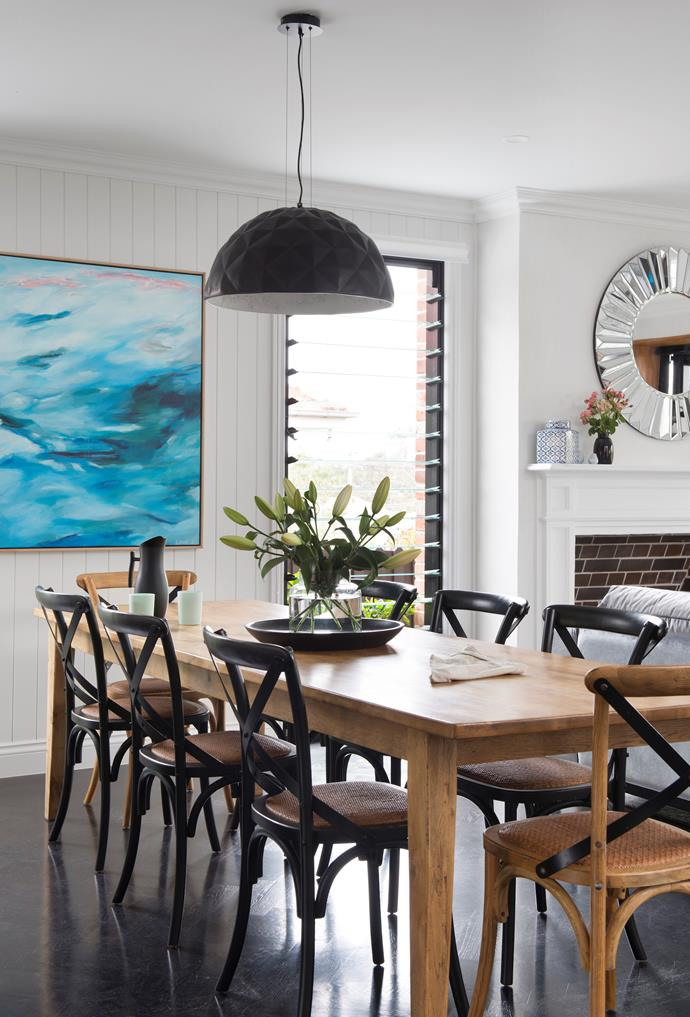 In the dining area, watery hues inspired a commission piece titled Cloud Valley by artist Rachel Prince, which complements a replica 'Skygarden' pendant light from Mica Lighting.
