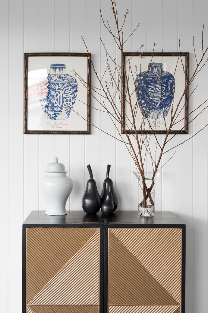A Coco Republic 'Rawson' bar cabinet is restocked at Christmas, for after-dinner drinks with friends. On the wall, a pair of prints from Olive Paddington is a nod to Hamptons sophistication.