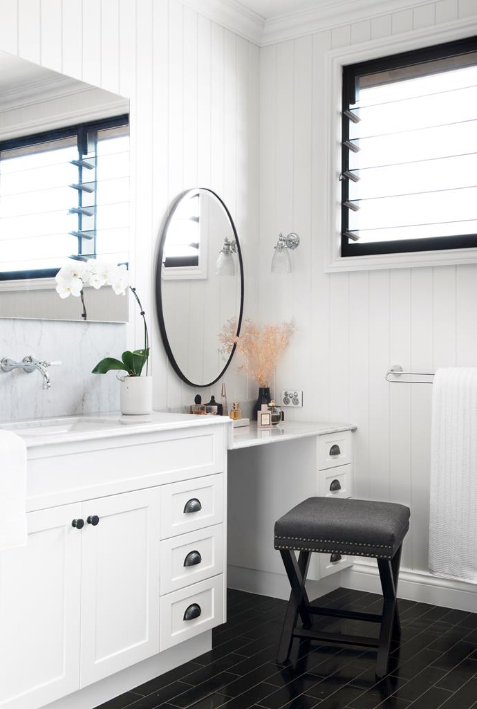 A luxe Carrara marble vanity drops down to form a make-up area, complete with a pretty mirror from Reflect Mirrors and stool from The French Corner.