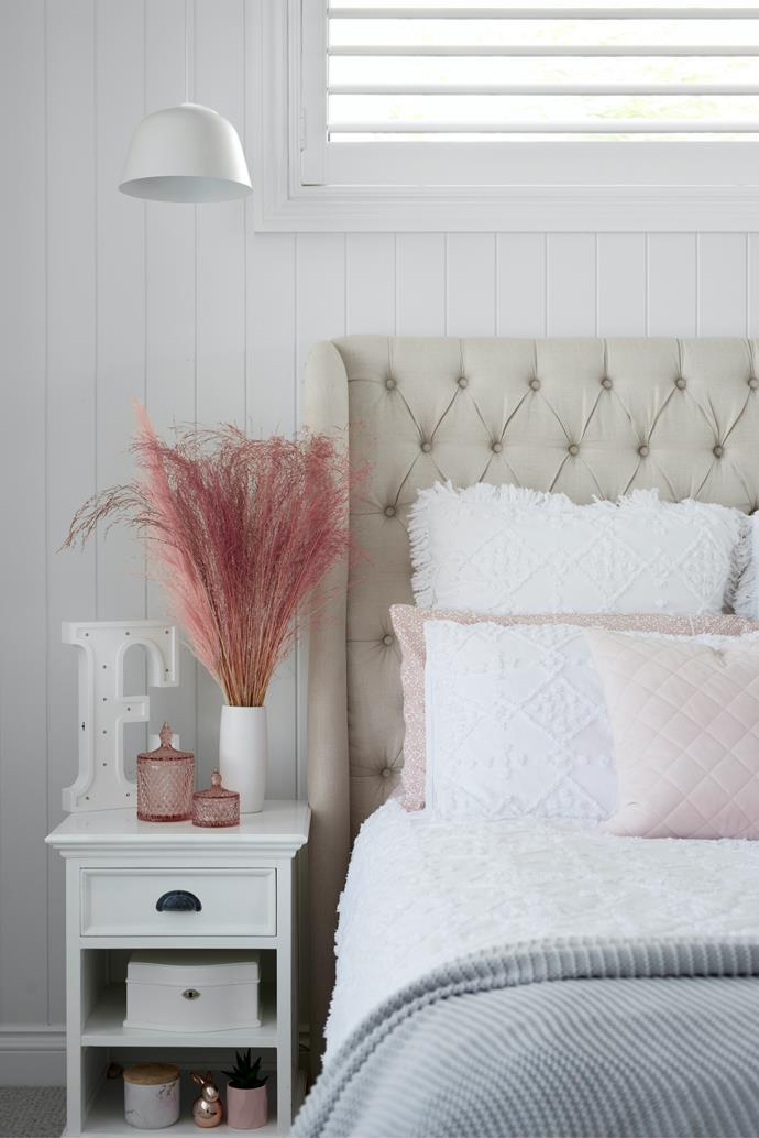Elli's bedroom features a bedhead from One World Collection.