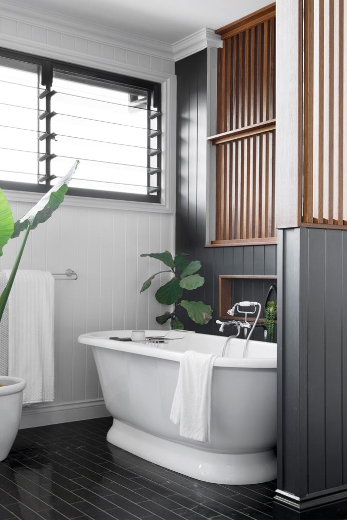 """Justine originally had another bath picked out, but at the last minute switched to a classic Victoria + Albert 'Elkwick' bath, paired with Bastow Georgian tapware from Reece. """"I just loved the elaborate, feminine style and I'm so glad we got it,"""" she says of the bath, which sits atop Nero Marquina subway tiles from The Tile Mob."""
