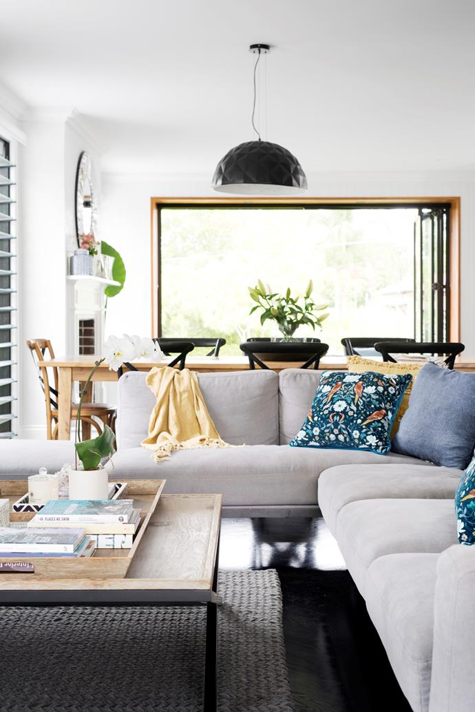 Although most furniture was bought specifically for the home, a timber coffee table the family has had for years works perfectly, with the steel legs providing a black accent, which is a recurring theme throughout. For a similar table try Provincial Home Living.