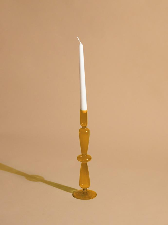 "Aeyre Fisca candlestick in amber, $139, [Reliquia Collective](https://reliquiacollective.com/collections/living/products/fisca-candlestick-amber|target=""_blank""