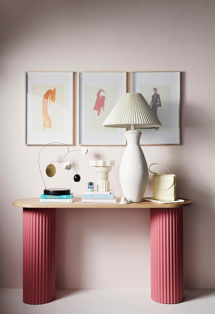 Ridge console in Oak, $2565, Beeline Design. Adler A2 poster frames in Natural, $99.95 each, Country Road. The Saffron Dress, The Pink Pose and The Suit artworks by Amelie Hegardt (30cm x 40cm), $47.50 each, Paper Collective. Eggshell acrylic paint in Petal Pink, $130 for 4L, Porter's Paints.