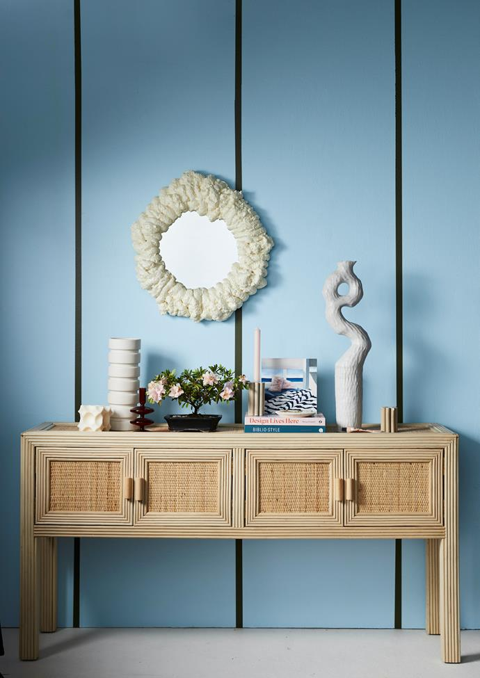 Airlie console in Natural Rattan, $1199, OZ Design. Annabel mirror, $119, McMullin & Co. Wash&Wear paint in Breezy Quarter, $79.90 for 4L, and Amazon Depths, $94.40 for 4L, Dulux.