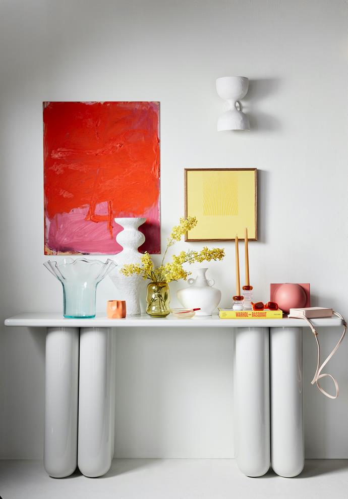 Bold console, $2625, Domo. The Poet And The Mystic artwork by Monique Lovering (81cm x 61cm), $3100, Curatorial+Co. Easy artwork by Kasper Raglus (36cm x 36cm), $750, Modern Times. Double cup wall light, $700, Anna Charlesworth. Wash&Wear paint in Vivid White, $79.90 for 4L, Dulux.