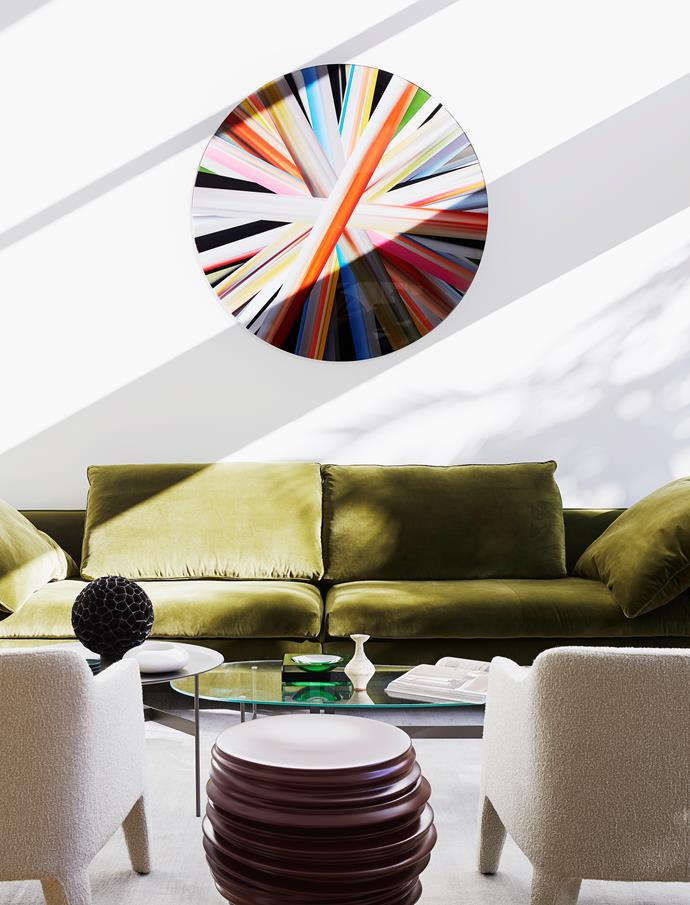 Molteni&C sofa, Hub Furniture. Armchairs, Jardan. Coffee table, Space. Wheel of Light artwork by Eduardo Santos. Rug, Armadillo.
