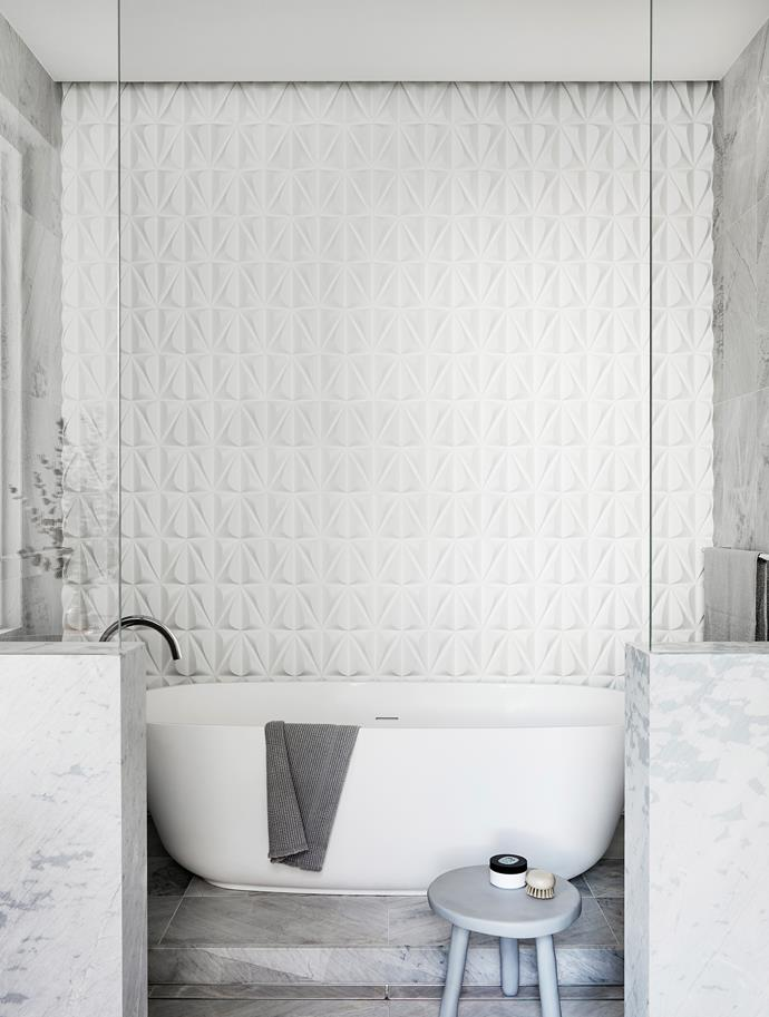 """The shapes and feel of the materials is very luxurious,""  says Sara. ""It's very much a ritual space."" Elba floor and wall tiles, Artedomus. Feature tiles, Kaza Concrete. Bath, Antonio Lupi. Stool, Oliver Thom"